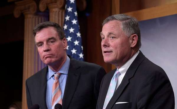 Senate Intelligence Committee Chairman Richard Burr, right, and