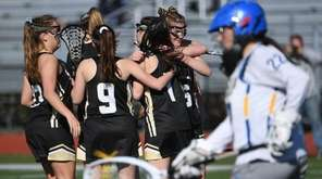 Sachem North players celebrate a goal by Hailey