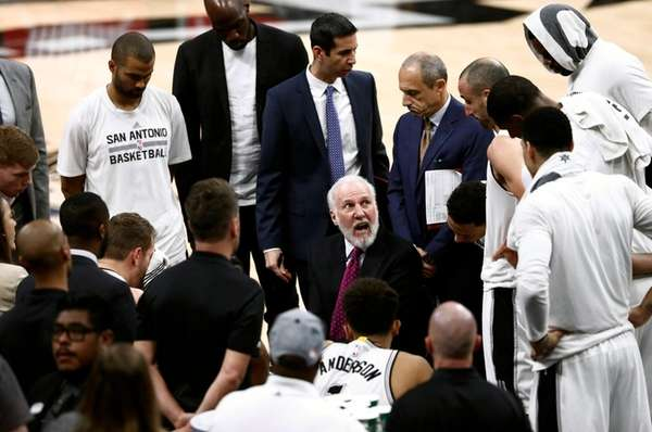 Spurs coach Gregg Popovich talks to his team
