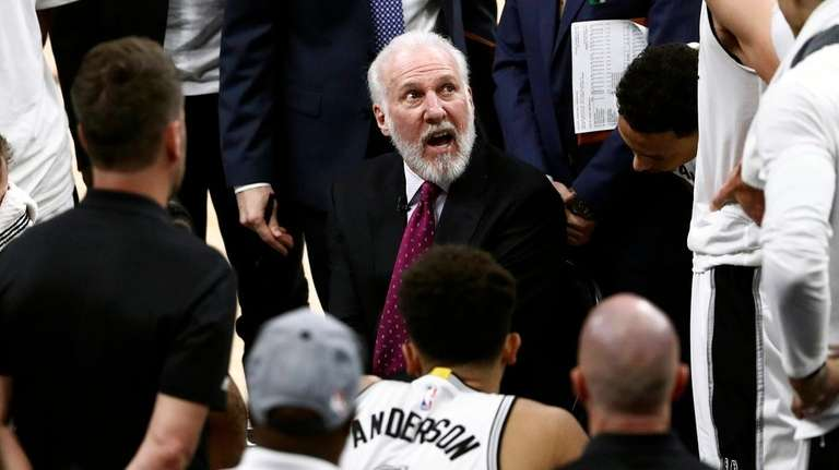 Spurs coach Gregg Popovich talks to his team