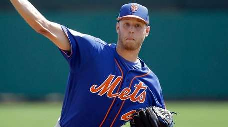 New York Mets starting pitcher Zack Wheeler throws
