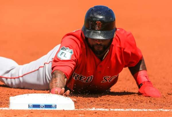 Boston Red Sox third baseman Pablo Sandoval dives