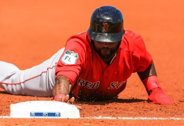 Boston Red Sox third baseman Pablo Sandoval dives