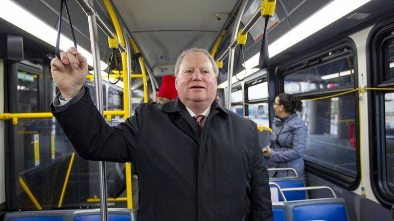 Sheldon Shrenkel, center, chairman of the Nassau Transit