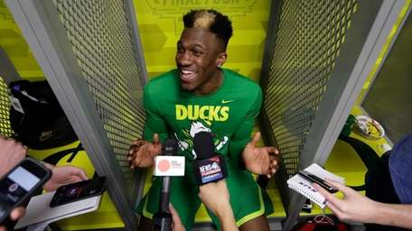Oregon's Dylan Ennis answers questions after a practice