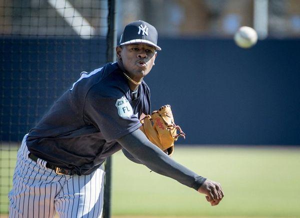 New York Yankeespitcher Luis Severino pitchesduring batting practice