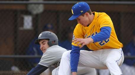 East Meadow pitcher Patrick Hoffman #22 right, tries