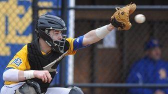 East Meadow catcher John Grigonis #4 tries to