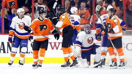 Philadelphia Flyers' Jordan Weal, left center, celebrates his