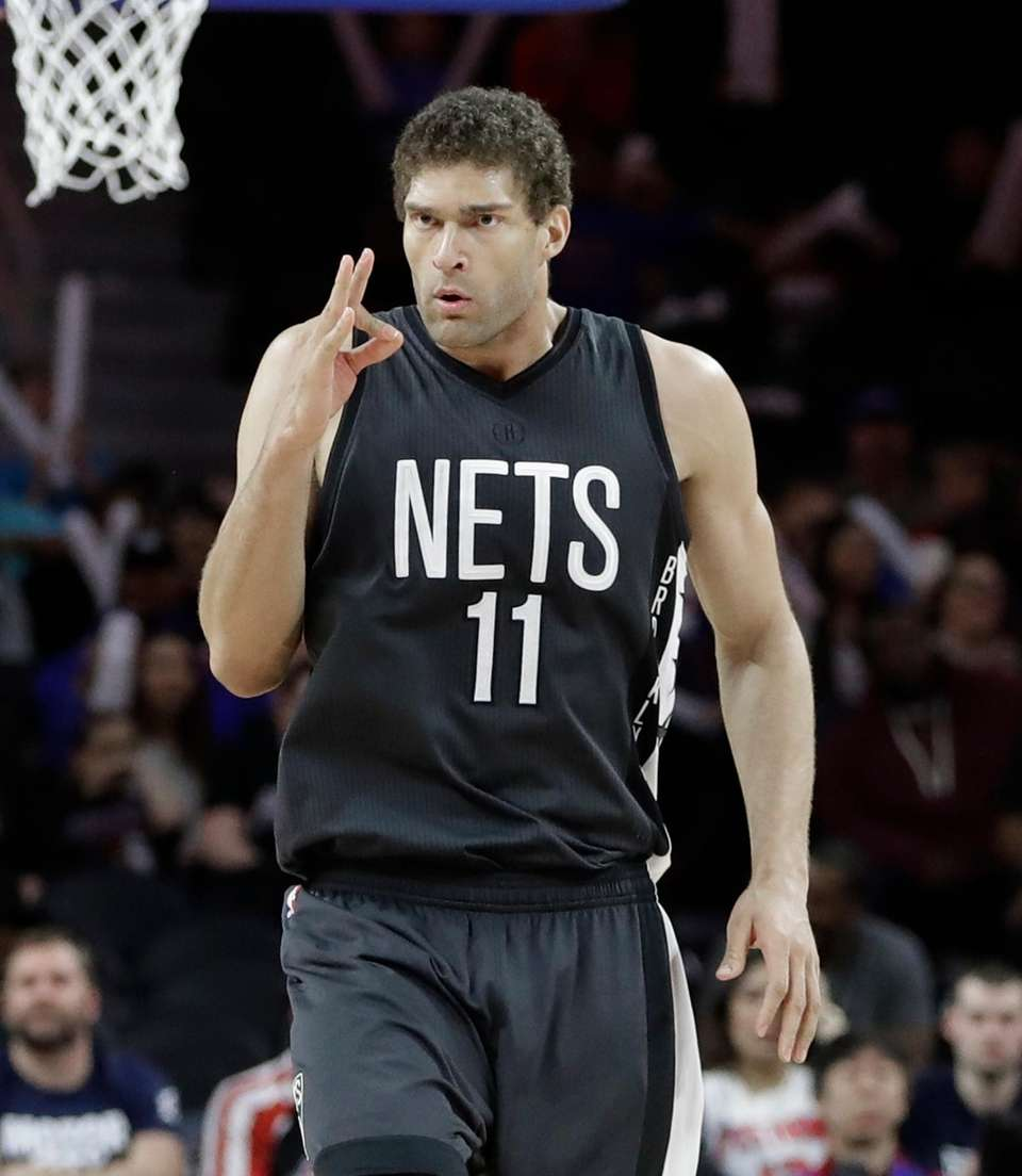 Brooklyn Nets center Brook Lopez gestures toward the