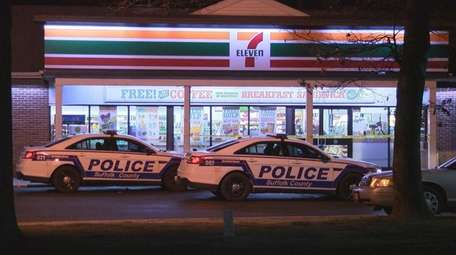Suffolk County police investigate the robbery of a