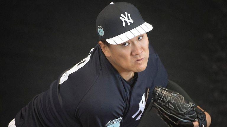 New York Yankees pitcher Masahiro Tanaka throws in