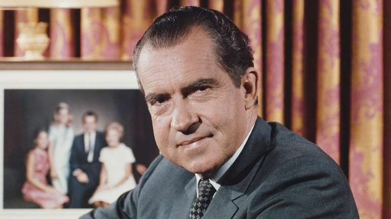 Richard Nixon in front of a family portrait
