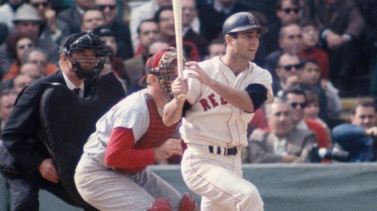 Red Sox outfielder Carl Yastrzemski swings against the