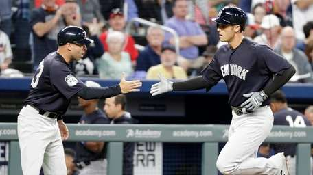 New York Yankees' Greg Bird, right, high-fives third