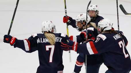 Brianna Decker #14 of United States celebrates her