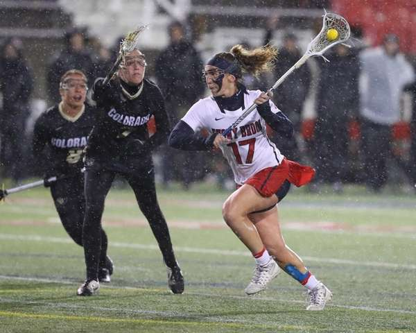 Stony Brook's Kylie Ohlmiller drives past Colorado defenders