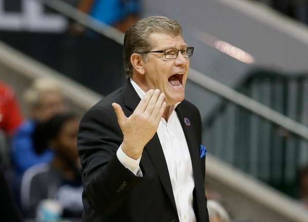 Connecticut head coach Geno Auriemma calls to his