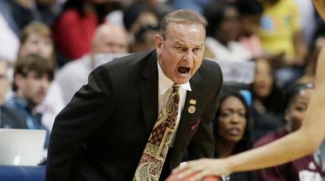 Mississippi State head coach Vic Schaefer, left, calls