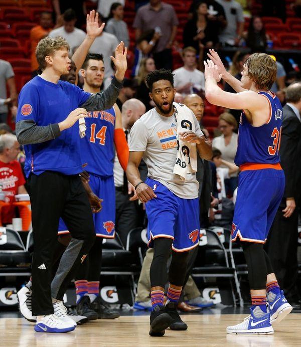 New York Knicks' Ron Baker, right, celebrates with