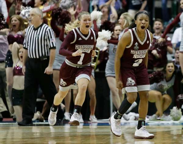 Mississippi State guard Morgan William (2) celebrates after