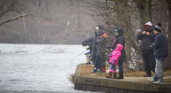 People fish at Belmont Lake State Park in