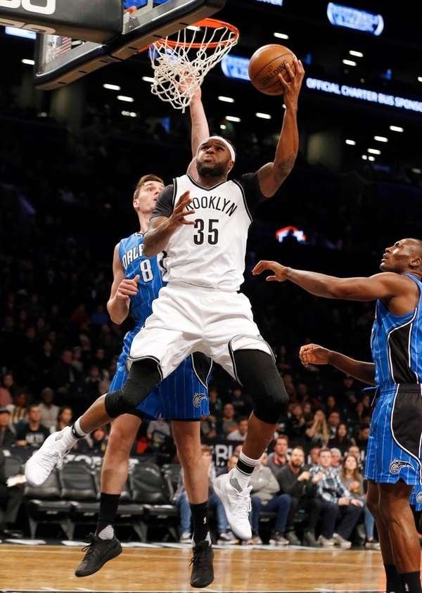 Trevor Booker #35 of the Brooklyn Nets lays