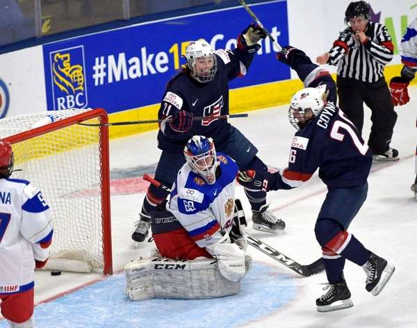 The United States' Kendall Coyne (26) and Hilary