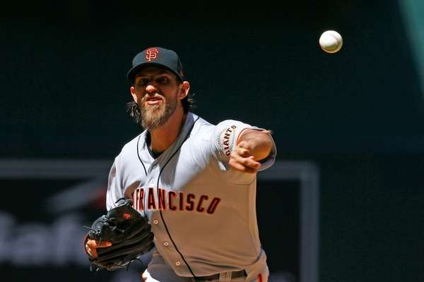 San Francisco Giants' Madison Bumgarner throws a pitch