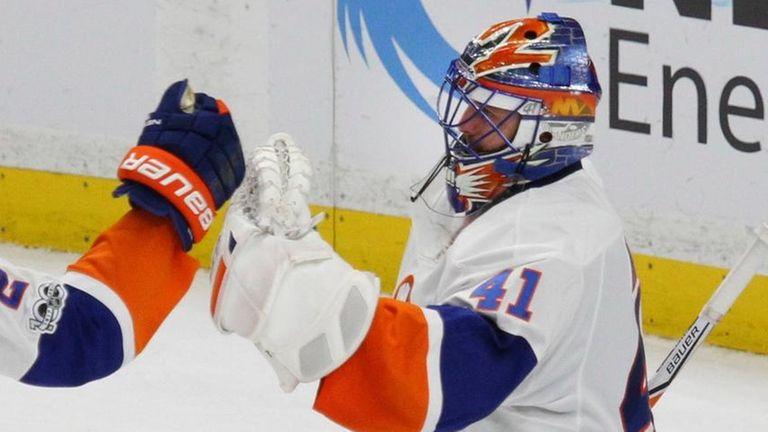 New York Islanders' Nick Leddy (2) and Jaroslav