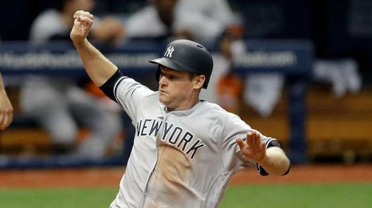 New York Yankees' Chase Headley scores in front