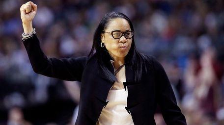 South Carolina head coach Dawn Staley signals to