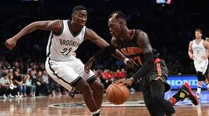 Atlanta Hawks guard Dennis Schroder drives to the