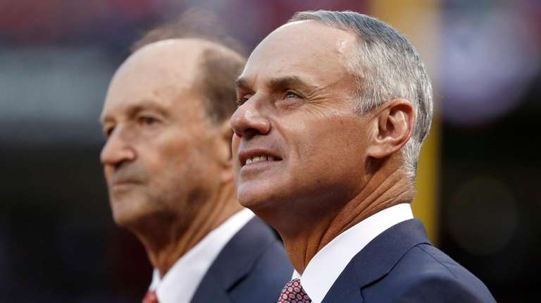 Major League Baseball Commissioner Rob Manfred, right, and