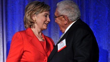 U.S. Secretary of State Hillary Clinton, left, greets
