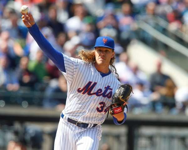 New York Mets starting pitcher Noah Syndergaard throws to
