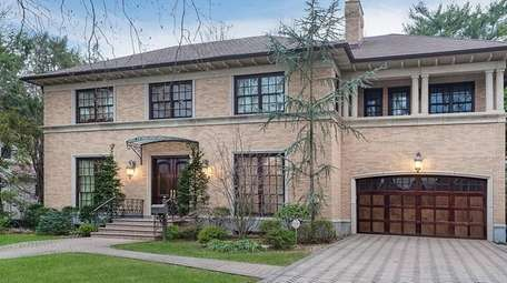 This Garden City Colonial-style manse includes an indoor