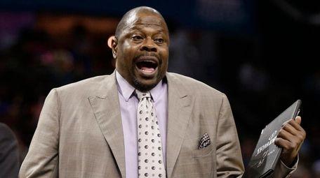 Charlotte Hornets assistant coach Patrick Ewing argues a