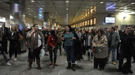Late-afternoon commuters at Penn Station in Manhattan on