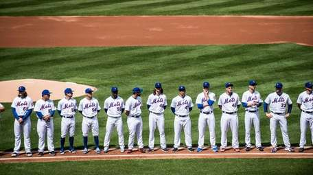 Mets players line up at the start of