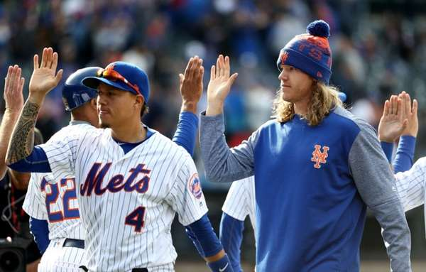 Wilmer Flores #4 and Noah Syndergaard #34 of