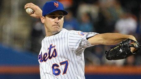 New York Mets starting pitcher Seth Lugo delivers