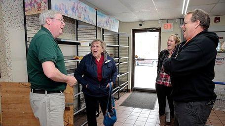 McCarrick's Dairy co-owner Hugh McCarrick, left, speaks with
