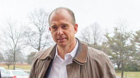 Hempstead Town Councilman Edward Ambrosino surrenders at a