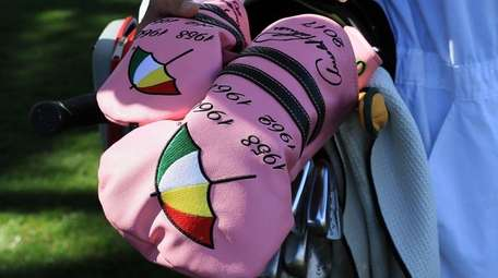 Headcovers honoring Arnold Palmer and his Masters' wins