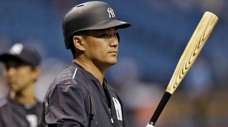 New York Yankees pitcher Masahiro Tanaka waits his