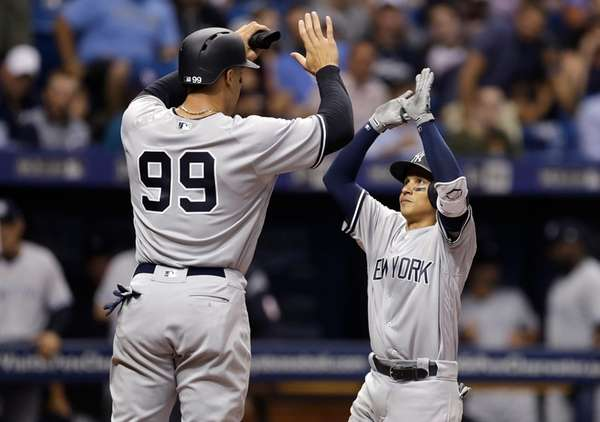 Yankees homer twice to back Sabathia in win over Rays