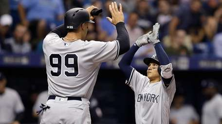 New York Yankees' Ronald Torreyes, right, high fives