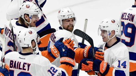 New York Islanders' Thomas Hickey (14) celebrates with