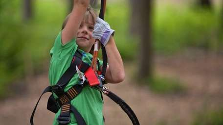 Blake Young of Islip, swings on a zip